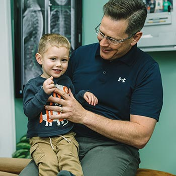 Chiropractor Randolph NJ Patrick Ryan with Child Patient